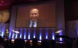 Larry Summers tijdens een videoconferentie